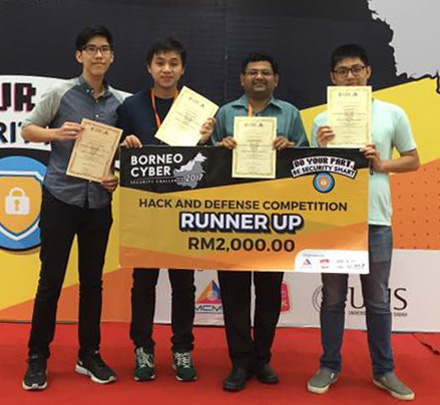 (from left) Yong, Son, Dr. Valliappan and Tan with their prize money and certificates of participation.