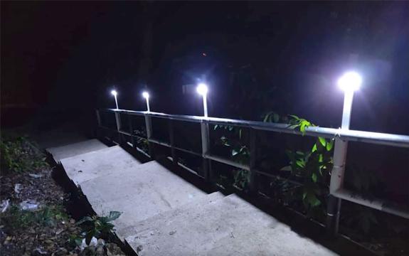 Solar lights brighten main pathways at night.