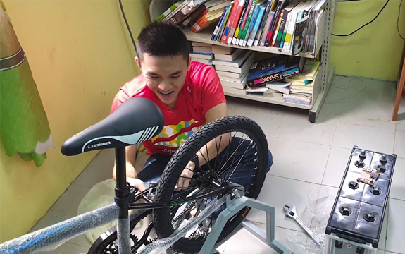 A Swinburne student connects the bicycle to a generator.